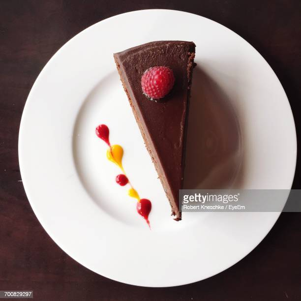 high angle view of sachertorte in plate on table - chocolate cake above stock pictures, royalty-free photos & images