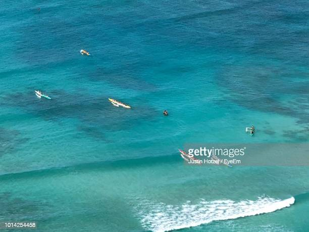 high angle view of sailboat in sea - waikiki stock pictures, royalty-free photos & images