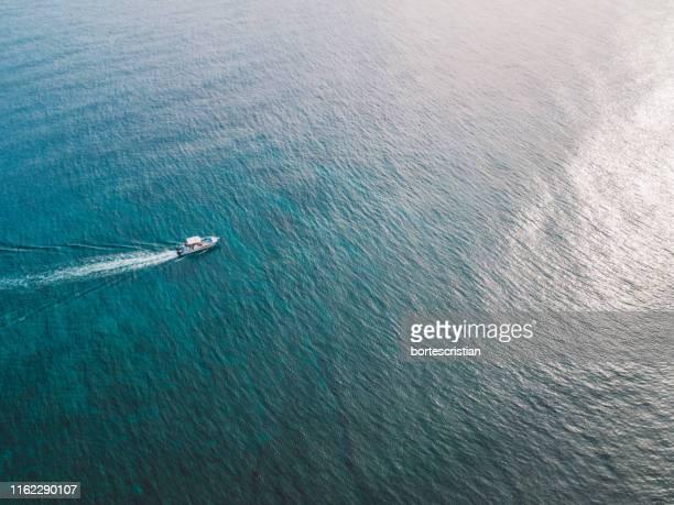 high angle view of sailboat in sea - bortes stockfoto's en -beelden
