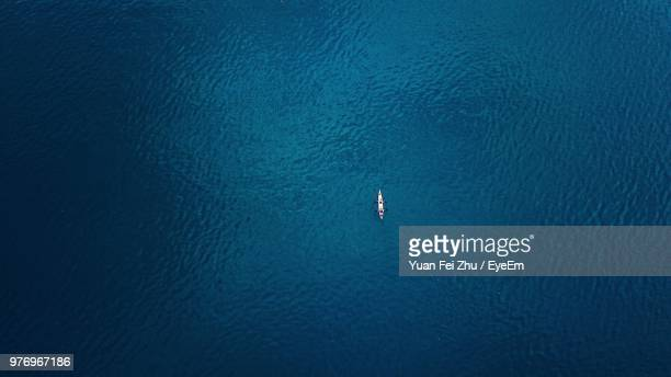 high angle view of sailboat in sea - tranquil scene stock pictures, royalty-free photos & images