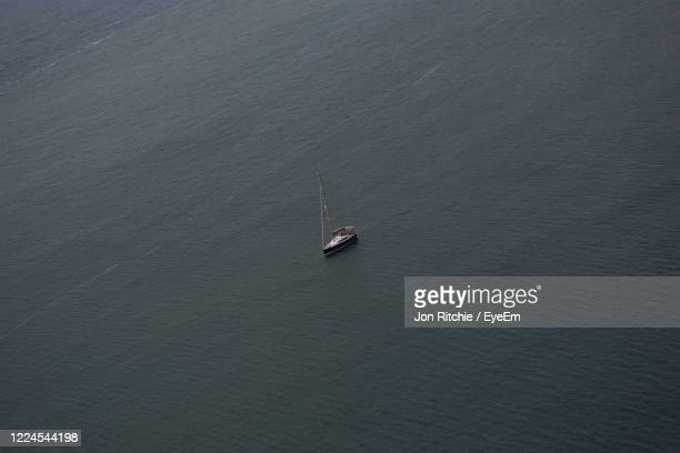 high angle view of sailboat on sea - alum bay stock pictures, royalty-free photos & images