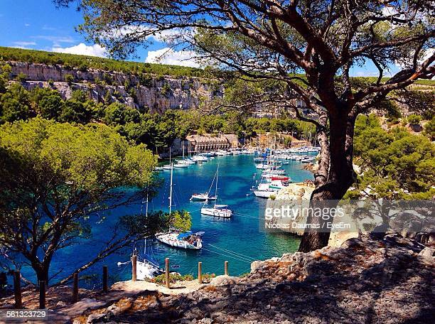 high angle view of sailboats moored in river at calanque de port-miou - cassis stock pictures, royalty-free photos & images