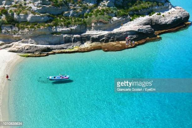 high angle view of sailboats on sea shore - calabria stock pictures, royalty-free photos & images