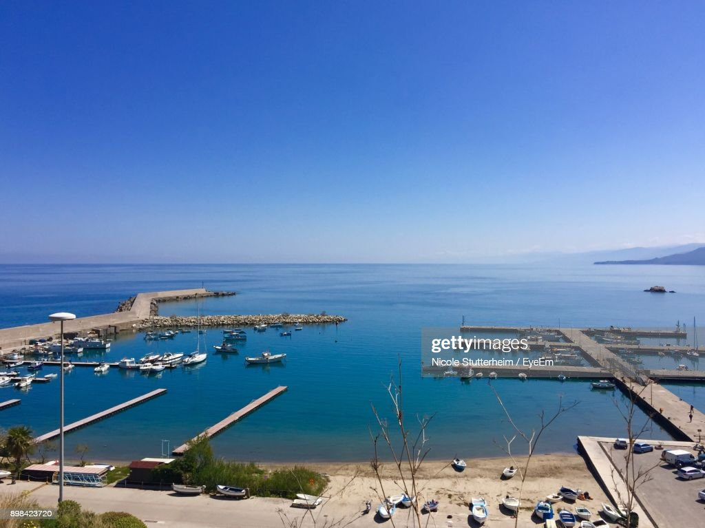 High Angle View Of Sailboats Sailing In Sea Against Clear Blue Sky : Stock Photo