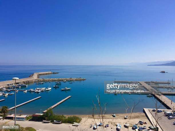 high angle view of sailboats sailing in sea against clear blue sky - stutterheim stock photos and pictures