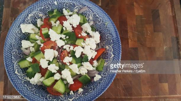 high angle view of salad in plate on table - feta cheese stock pictures, royalty-free photos & images