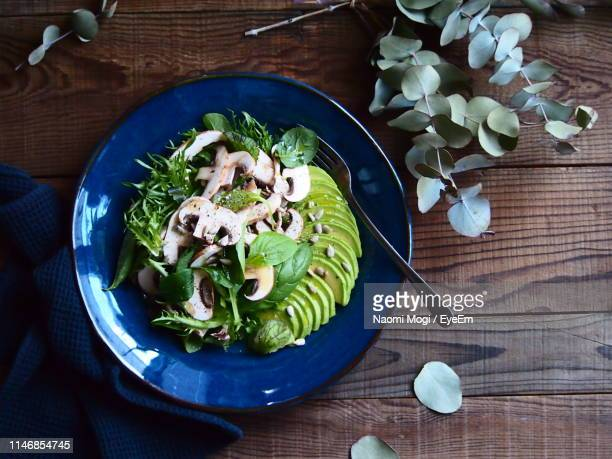 high angle view of salad served in plate on wooden table - naomi mogi ストックフォトと画像