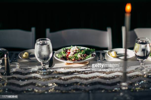high angle view of salad with drink on table at home - monty shadow stock photos and pictures