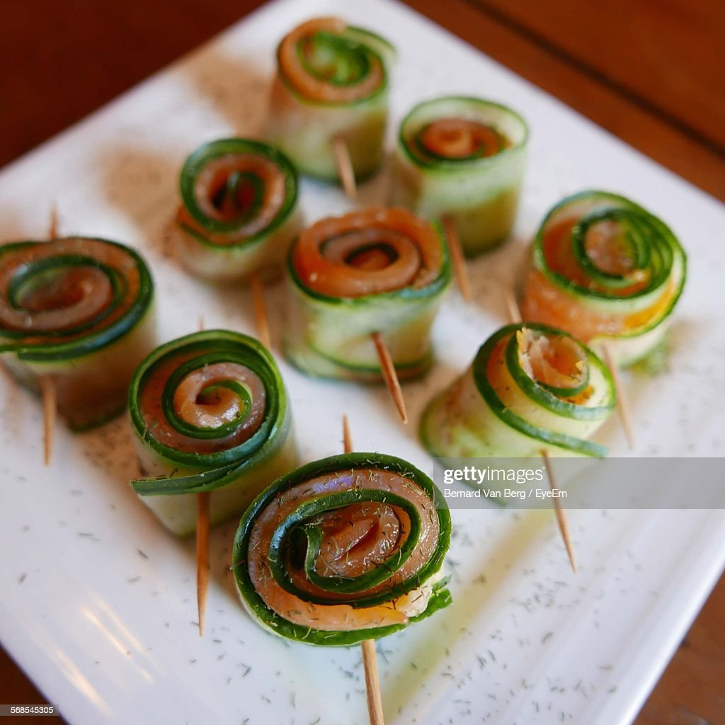 High Angle View Of Salmon Rolls In Plate : Stock Photo