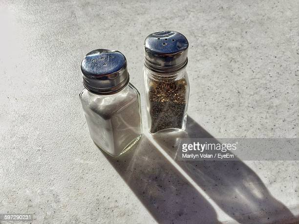High Angle View Of Salt And Pepper Shakers On Table