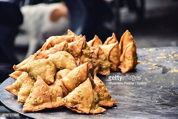 high angle view of samosas on market stall - samosa stock photos and pictures