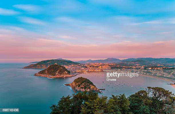high angle view of san sebastian (donostia) city during sunset. spain. - san sebastian spain stock pictures, royalty-free photos & images