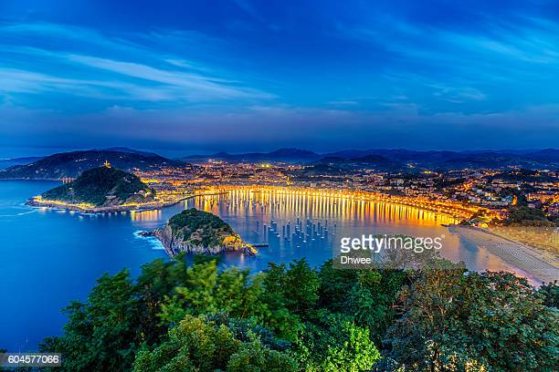 high angle view of san sebastian or donostia city during the blue hour, spain - san sebastian spain stock pictures, royalty-free photos & images