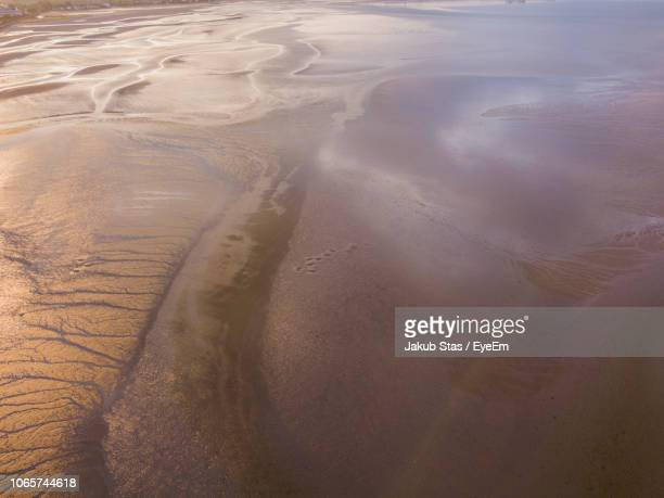 high angle view of sand dunes at beach - blackrock stock pictures, royalty-free photos & images
