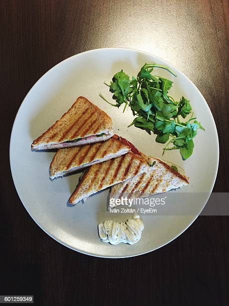 high angle view of sandwiches in plate on table - iván zoltán stock pictures, royalty-free photos & images