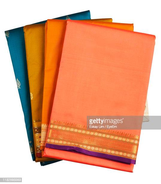 high angle view of sari against white background - sari stock pictures, royalty-free photos & images