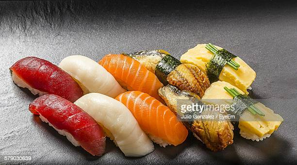 High Angle View Of Sashimi On Wooden Plate
