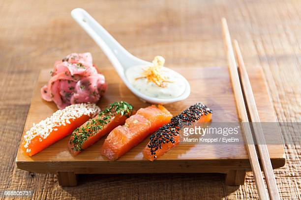 High Angle View Of Sashimi With Chopsticks On Table