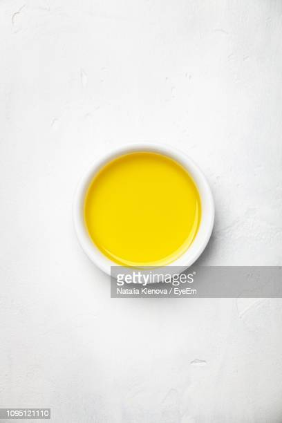 high angle view of sauce in plate over white background - sauce stock pictures, royalty-free photos & images
