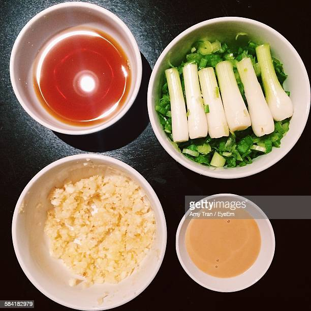 High Angle View Of Sauces And Ingredients For Shabu Shabu