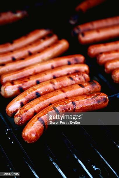 High Angle View Of Sausages Grilling On Barbecue