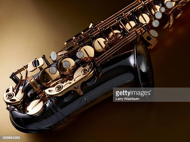 High angle view of saxophone against colored background
