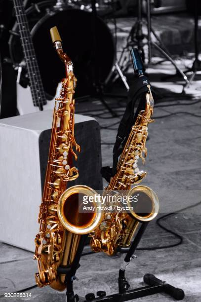 High Angle View Of Saxophones On Footpath