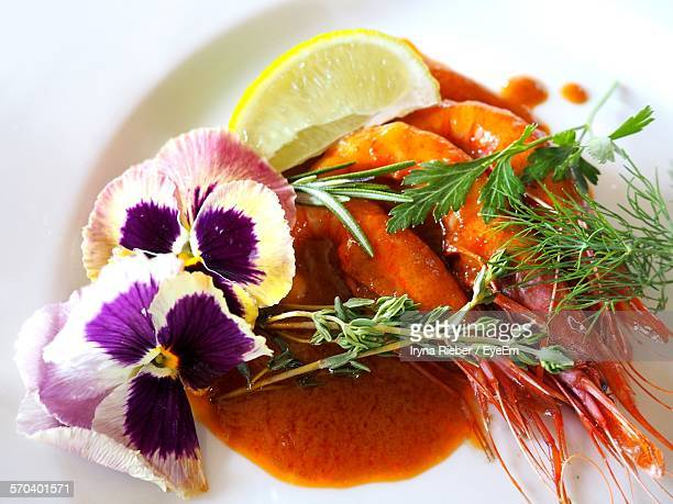 High Angle View Of Scampi Garnished With Flowers On Plate