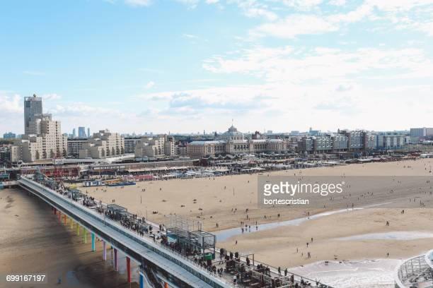 high angle view of scheveningen pier at beach in city - bortes cristian stock-fotos und bilder