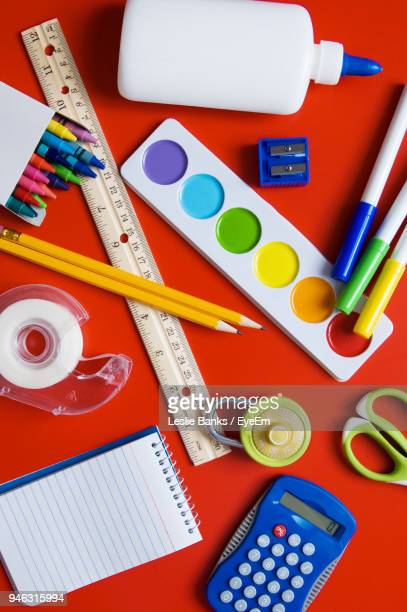 High Angle View Of School Supplies On Table