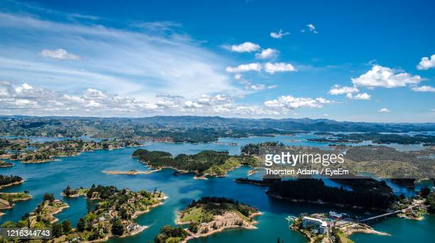 high angle view of sea against blue sky - guatapé stock pictures, royalty-free photos & images