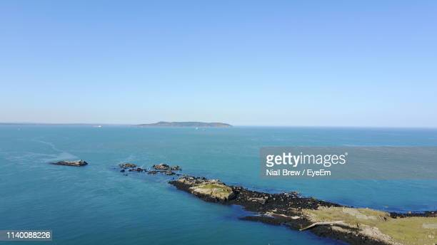 high angle view of sea against clear sky - dalkey stock pictures, royalty-free photos & images