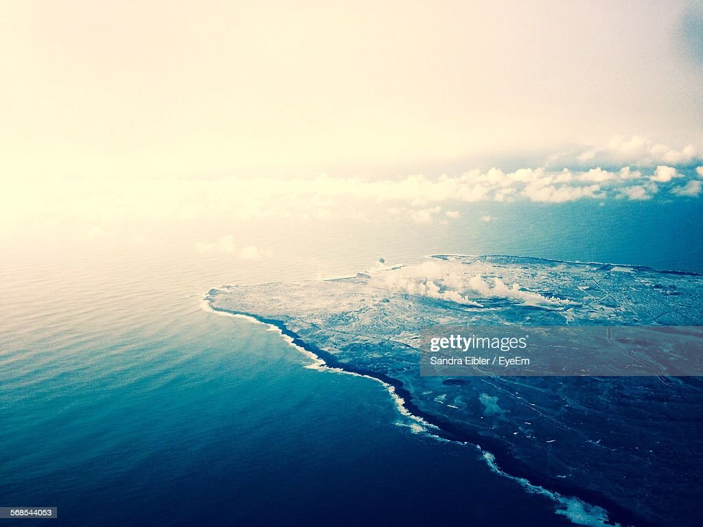 High Angle View Of Sea Against Cloudy Sky At Sunset : Stock Photo