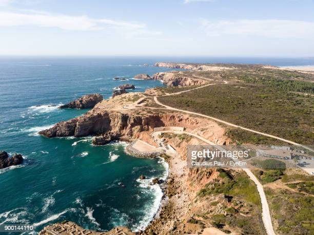 high angle view of sea against cloudy sky - faro stock photos and pictures