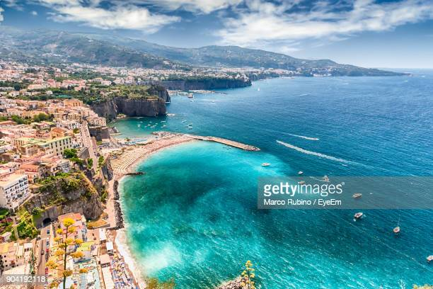 high angle view of sea against cloudy sky - sorrento stock pictures, royalty-free photos & images