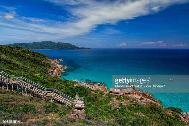 high angle view of sea against cloudy sky - terengganu stock pictures, royalty-free photos & images