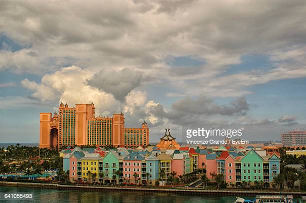high angle view of sea against colorful buildings in city - ナッソー ストックフォトと画像