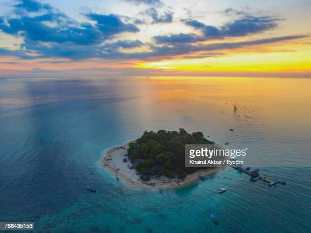 High Angle View Of Sea Against Sky At Sunset