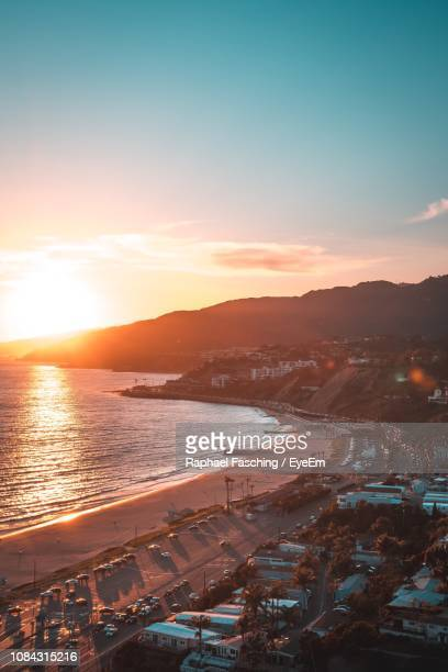 high angle view of sea against sky during sunset - malibu beach stock pictures, royalty-free photos & images