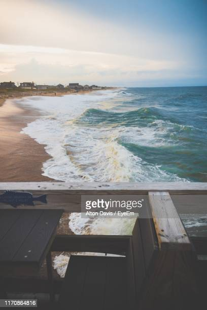 high angle view of sea against sky during sunset - kitty hawk beach stock pictures, royalty-free photos & images