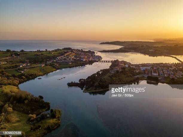 high angle view of sea against sky during sunset,san vicente de la barquera,cantabria,spain - cantabria fotografías e imágenes de stock