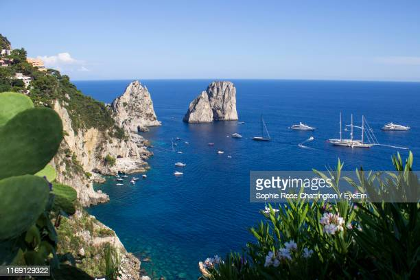 high angle view of sea against sky - capri stock pictures, royalty-free photos & images