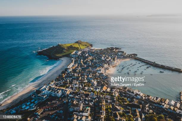 high angle view of sea against sky - st. ives cornwall stock pictures, royalty-free photos & images