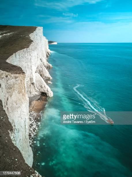 high angle view of sea against sky - sailing stock pictures, royalty-free photos & images