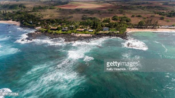 high angle view of sea against sky - haleiwa stock photos and pictures