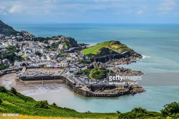 high angle view of sea against sky - ilfracombe stock photos and pictures