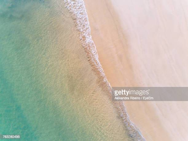 high angle view of sea and beach - praia imagens e fotografias de stock