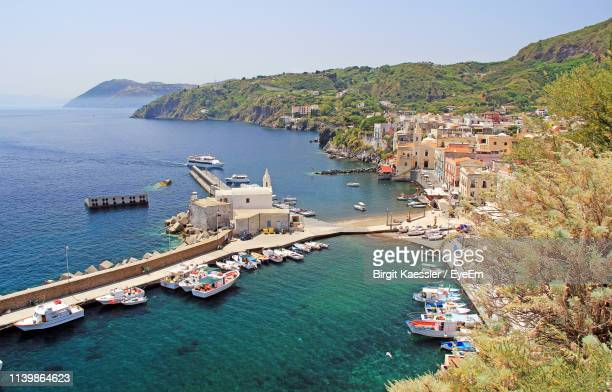 high angle view of sea and buildings against clear sky - insel lipari stock-fotos und bilder
