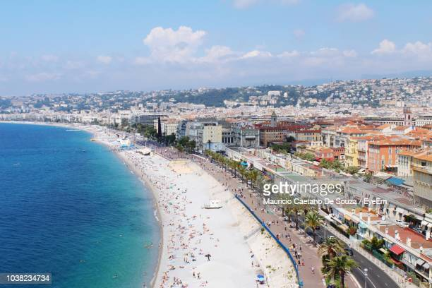 high angle view of sea and buildings against sky - mauricio caetano de souza stock photos and pictures