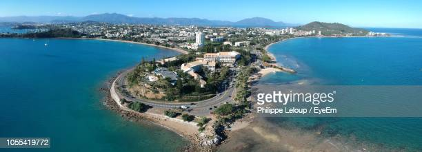 high angle view of sea and buildings against sky - new caledonia stock photos and pictures